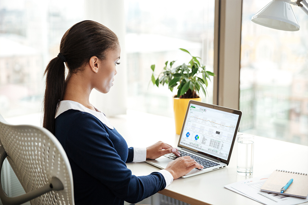 businesswoman using AutoQuotes software on her laptop