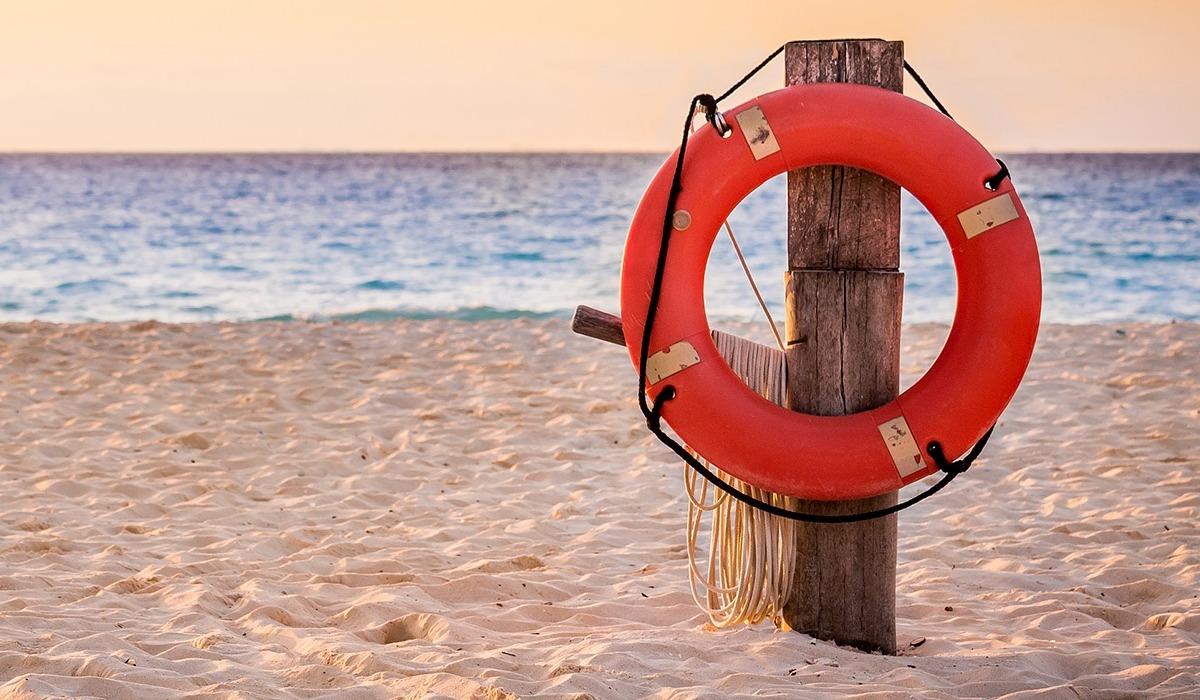 lifesaver hanging on a pole on a beach